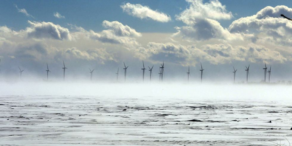 The wind turbines on Wolfe Island are partially obscured by blowing snow during a cold and windy winter day in Kingston recently.  IAN MACALPINE/KINGSTON WHIG-STANDARD/QMI AGENCY