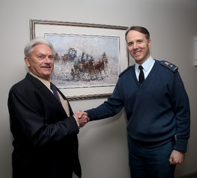 James Keirstead (left) Royal Military College Commandant Brig.-Gen. Al Meinzinger with one of Keirstead's paintings that's being donated to the Royal Military College.  IAN MACALPINE/KINGSTON WHIG-STANDARD/QMI AGENCY