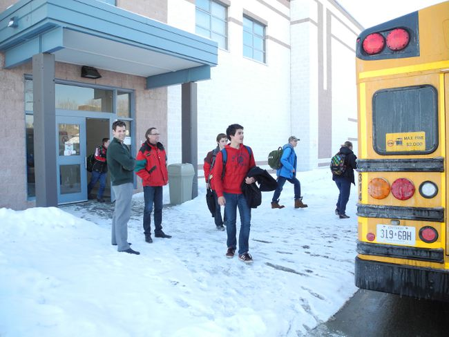 L'Heritage vice-principal Eric Genier (green sweater) and French teacher Andre Villeneuve (red jacket) supervise students heading to their school buses, Wednesday. L'Heritage is one of the most improved high schools in Canada.