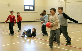 A group of day campers play a spirited game of dodge ball during a March Break day camp. Some of their activities included games, sports, crafts and swimming.