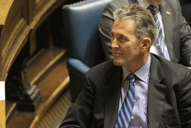 Opposition Leader Brian Pallister looks at a backbencher as the NDP delivered the provincial budget speech at the Manitoba Legislative Building in Winnipeg, Man., on Thu., March 6, 2014. Kevin King/Winnipeg Sun/QMI Agency