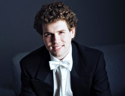 Evan Mitchell will replace Glen Fast as the musical director and conductor of the Kingston Symphony.