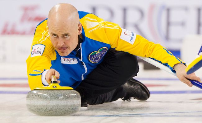 Team Alberta skip Kevin Koe delivers a stone in the 2nd end against Team Prince Edward Island during the 2014 Brier curling championship in Kamloops, B.C., March 6, 2014. (BEN NELMS/Reuters)