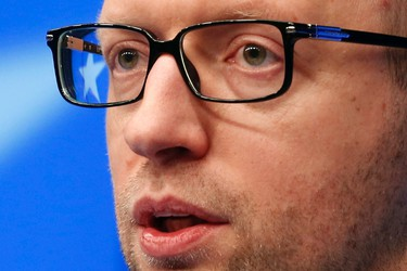 Ukraine's Prime Minister Arseniy Yatsenyuk holds a news conference during a European leaders emergency summit on Ukraine, in Brussels March 6, 2014. Yatseniuk said on Thursday that a decree making Crimea part of Russia was an illegitimate move and Crimea was and will remain an integral part of the country. REUTERS/Pascal Rossignol