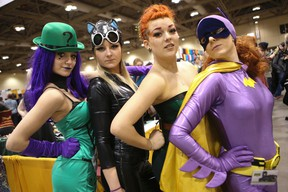 The Moffat girls dressed as their favourite Batman characters on March 7, 2014. Tamara is the Riddler, Natasha as Catwoman , Tatiana as Poison Ivy and Melissa as the original BatGirl. ComiCon runs all weekend at the Metro Toronto Convention Centre south building.  (Jack Boland/Toronto Sun)