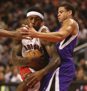 Raptors' John Salmons (left) cuts in on the Kings' Ray McCallum during Friday night's game at the Air Canada Centre. (JACK BOLAND/TORONTO SUN)