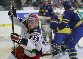 Russia's Evgeny Kuznetsov (L) celebrates after scoring against Sweden during their Euro Hockey Tour ice hockey match in Brno April 28, 2012.    (REUTERS)