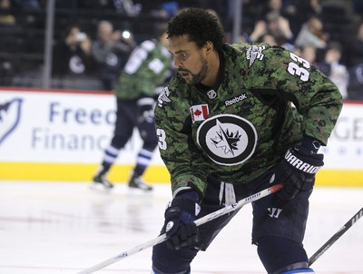 Winnipeg Jets defenceman Dustin Byfuglien skates prior to a game against the Ottawa Senators in NHL action at MTS Centre in Winnipeg, Man., on Sat., March 8, 2014. The Jets wore camouflauge warmup jerseys for Canadian Armed Forces Appreciation 2014. The jerseys will be auctioned off in support of charity. Kevin King/Winnipeg Sun/QMI Agency