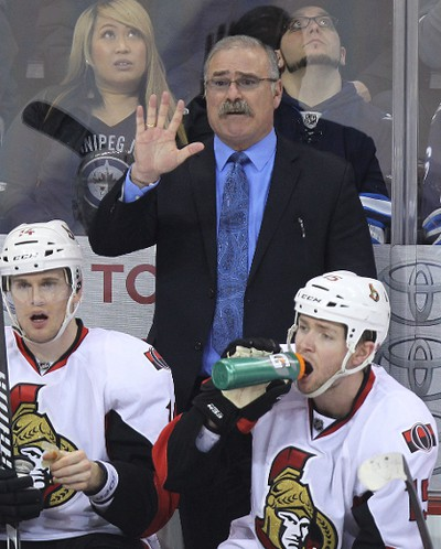 Ottawa Senators head coach Paul MacLean, a former Winnipeg Jet, argues for a five-minute penalty during second-period NHL action against the Jets at MTS Centre in Winnipeg, Man., on Sat., March 8, 2014. Kevin King/Winnipeg Sun/QMI Agency