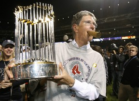 Boston Red Sox principal owner John Henry holds the World Series trophy during celebrations in Denver, Colorado, in this October 28, 2007 file photo (REUTERS/Lucy Nicholson/Files)