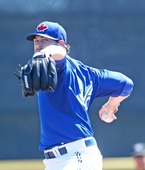 Blue Jays pitcher Drew Hutchison winds up during Saturday's exhibition game against the Minnesota Twins in Dunedin. The young right-hander tossed three strong innings. (Veronica Henri, Toronto Sun)