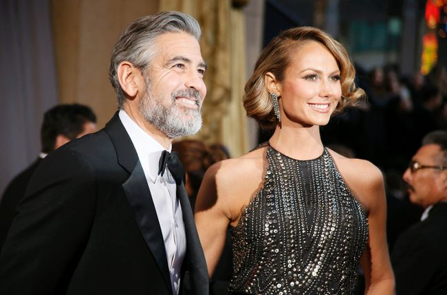 George Clooney arrives at the 85th Academy Awards with Stacy Keibler, in Hollywood, Calif., Feb. 24, 2013.  REUTERS/Lucy Nicholson