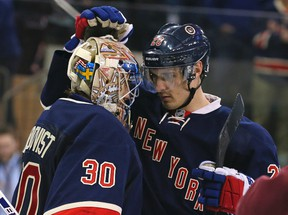 New York Rangers goalie Henrik Lundqvist (30) and New York Rangers left wing Chris Kreider (20) celebrate after defeating the Detroit Red Wings at Madison Square Garden. (Adam Hunger-USA TODAY Sports)