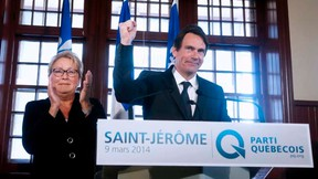 Pierre Karl Peladeau (R), former president and CEO of Quebecor Inc., gestures after being announced as the Parti Quebecois candidate for the riding of Saint-Jerome by leader Pauline Marois during a campaign stop in Saint-Jerome, Quebec, March 9,  2014. REUTERS/Christinne Muschi