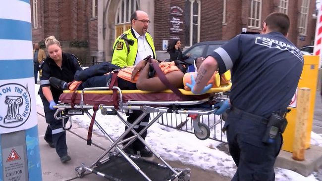 Paramedics rush a man to St. Michael's hospital after he was stabbed during a church service Sunday afternoon. (JOHN HANLEY/Special to the Toronto Sun)