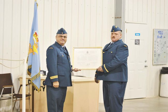 Area Cadet Officer Capt. Mitchell Krasey was in Whitecourt on Wednesday, March 5 to Whitecourt 721 Hawk Squadron training officer 2 nd Lt. Ken Westling with his commissioning scroll.