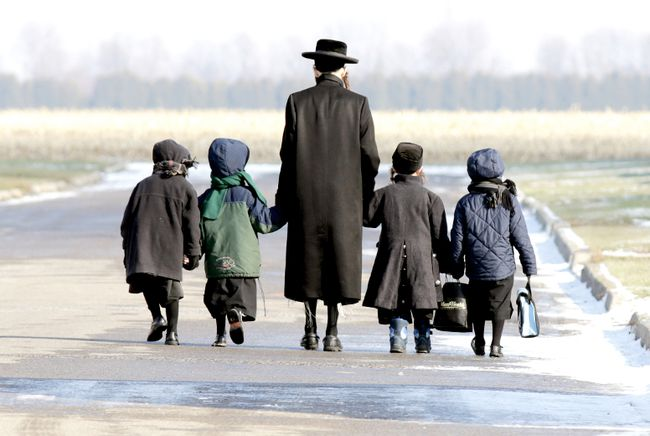 Lev Tahor children are walked home during the lunch hour from the makeshift school they attended in Chatham, Ont., in November. (QMI Agency file photo)
