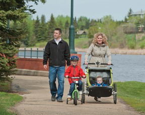 A family goes out for a stroll on one of Camrose's many walking trails.