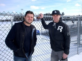 Kingston natives Mike Giffin, left, now retired from the CFL, and Rob Bagg of the Grey Cup champion Saskatchewan Roughriders are hosting a football skills and coaching camp at CaraCo Field April 25-27. (Ian MacAlpine/The Whig-Standard)
