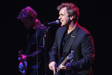 Bassist and singer Jason Scheff (right) and guitarist Keith Howland, with Chicago, perform at the Winspear Centre in Edmonton, Alta., on Monday, March 10, 2014. The American band was recently inducted into the Grammy Hall of Fame. Ian Kucerak/Edmonton Sun/QMI Agency