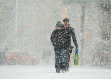 Another blast of winter hits the pedestrians at Yonge and Dundas  Sts. on Wednesday. (ERNEST DOROSZUK/Toronto Sun)