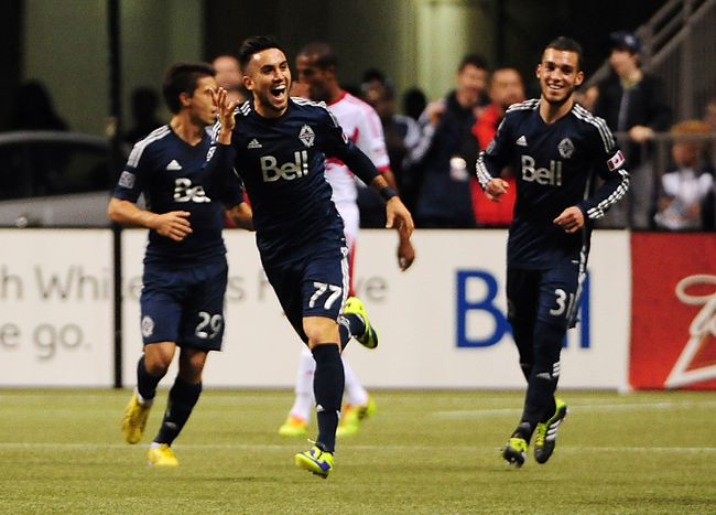 Whitecaps midfielder Pedro Morales (77) celebrates after scoring a goal against New York Red Bulls goalkeeper Luis Robles (not pictured) during the second half at BC Place. The Vancouver Whitecaps won 4-1, Mar 8, 2014; Vancouver, B.C. (Photo: Anne-Marie Sorvin-USA TODAY Sports)