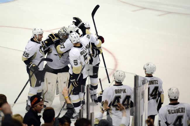 Pittsburgh Penguins goalie Marc-Andre Fleury celebrates with his team after blocking a shot during the shootout against the Anaheim Ducks at Honda Center. The Pittsburgh Penguins defeated the Anaheim Ducks in a shootout with a final score of 3-2. (Kelvin Kuo/USA TODAY Sports)