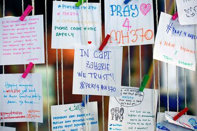 A message for pilot Zaharie Ahmad Shah (C), captain of the missing Malaysia Airlines Flight MH370, is pictured at an event to express solidarity to the family members of passengers onboard the plane, in Subang Jaya March 16, 2014. Police are combing through the personal, political and religious backgrounds of pilots and crew of the missing Malaysian jetliner, a senior officer said on Sunday, trying to work out why someone aboard flew the plane hundreds of miles off course.  REUTERS/Samsul Said