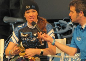 Clara Hughes, interviewed by Randy Ferguson on stage at the Ursuline College Theatre on March 17, holds the first two Olympic medals she won - bronze medals for cycling at the 1996 games in Atlanta. She went on to win one gold, one silver and two bronze medals in speed skating over the course of three different Winter Olympics. She is the only person in the world to have won multiple medals at both the the summer and winter games.
