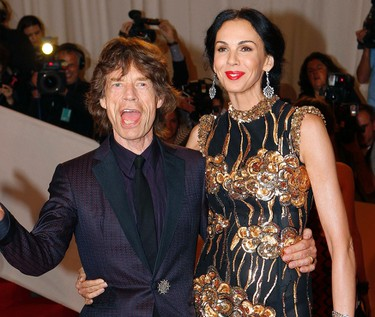 Mick Jagger and designer L'Wren Scott pose on the red carpet at the Metropolitan Museum of Art Costume Institute Benefit celebrating the opening of Alexander McQueen: Savage Beauty, in New York, May 2, 2011. REUTERS/Mike Segar
