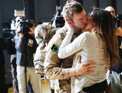 Canadian Army Master Corporal Anthony Alliot kisses Sarah Tooth after arriving from Afghanistan, in Ottawa March 18, 2014. Canada's 12-year mission in Afghanistan has formally ended, according to the military. REUTERS/Blair Gable