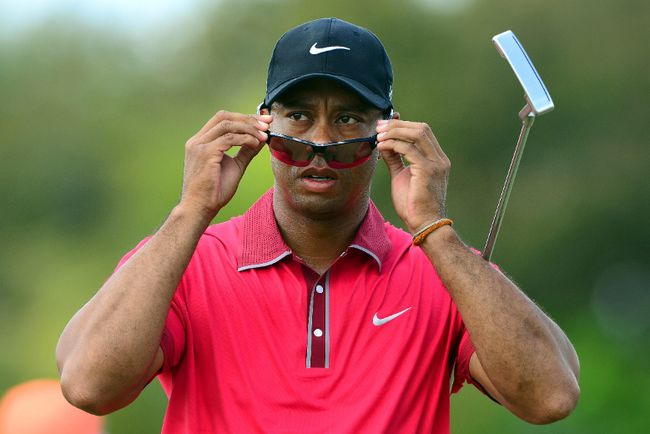 Tiger Woods puts on his sunglasses during the final round of the WGC - Cadillac Championship in Miami on Sunday, March 9, 2014. Woods is dealing with a bad back and is unsure of playing at the Masters next month. (Andrew Weber/USA TODAY Sports)