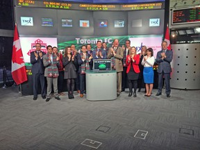 Members of TFC, including captain Steven Caldwell (centre), rang the bell to open the Toronto stock exchange yesterday on Bay Street. (TORONTO FC)