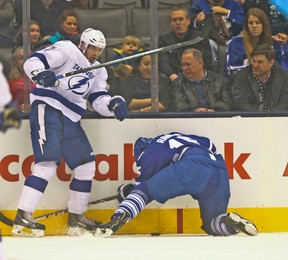 Leafs' Paul Ranger gets hammered into the end boards by Alex Killorn late in the first period. (JACK BOLAND/Toronto Sun)