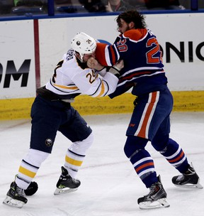 Oilers forward Luke Gazdic trades blows with Sabres' Zenon Konopka during the first period of Thursday's game at Rexall Place. (David Bloom, Edmonton Sun)