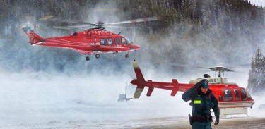 STARS air ambulance lifts off  for Calgary, with a man who was caught in an avalanche near Lake Louise, Alta. on Saturday March 15,2014. (Al Charest/QMI Agency)