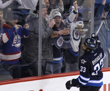 Winnipeg Jets forward Dustin Byfuglien celebrates his third-period goal against the Dallas Stars during NHL action at MTS Centre in Winnipeg, Man., on Sun., March 16, 2014. (Kevin King/QMI Agency)