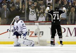 Pittsburgh Penguins centre Evgeni Malkin celebrates his game-winning goal in the shootout as Toronto Maple Leafs goalie Jonathan Bernier reacts on Nov. 27, 2013. (Charles LeClaire/USA TODAY Sports)