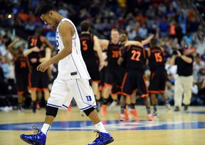 Duke Blue Devils guard Quinn Cook (2) walks off the court after losing to the Mercer Bears during the second round of the NCAA Tournament at PNC Arena. (Bob Donnan/USA TODAY Sports)