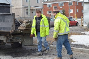 Crews were out patching potholes around the city Friday. But with  snowfall expected overnight, it may be more of a temporary fix.  Michelle Ferguson/For The Whig-Standard