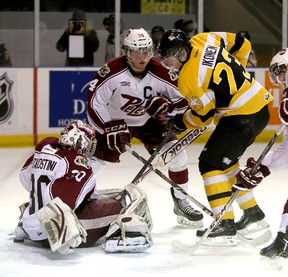Kingston Frontenacs Henri Ikonen pokes the puck past Peterborough Petes goalie Andrew D'Agostini as defenceman Connor Boland looks on during Ontario Hockey League Game 1 of the Eastern Conference quarter-final action at the Rogers K-Rock Centre on Friday. IAN MACALPINE/KINGSTON WHIG-STANDARD/QMI AGENCY