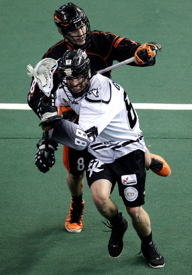 The Edmonton Rush's Zack Greer (88) battles the Buffalo Bandits' Kevin Brownell (8)during first half National Lacrosse League action at Rexall Place, in Edmonton Alta., on Friday March 21, 2014. David Bloom/Edmonton Sun/QMI Agency