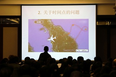 """A screen shows the questions from family members of passengers onboard Malaysia Airlines Flight MH370 after a routine briefing given by Malaysia's government and military representatives at Lido Hotel in Beijing March 22, 2014. Two weeks after a Malaysia Airlines airliner went missing with 239 people on board, officials are bracing for the """"long haul"""" as searches by more than two dozen countries turn up little but frustration and fresh questions. REUTERS/Jason Lee"""
