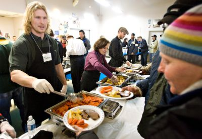 Edmonton, Alberta - March 21, 2010 - Edmonton Eskimo Mathieu Bertrand serves a meal at the Boyle Street mission on 101 St. and 105 Ave. on March 21, 2010. EDMONTON SUN/QMI PHOTO BY JORDAN VERLAGE  ****** KRISTY BROWNLEE STORY *******