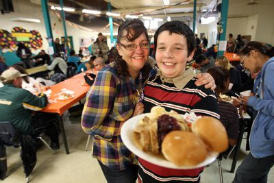 Debbie Exell and her 11 year old son James Exell are first time volunteers at the thanksgiving dinner at the Boyle Street Community Services' centre in Edmonton, Alberta on Oct. 7 , 2012.      PERRY MAH/EDMONTON SUN  QMI AGENCY