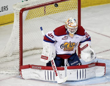 A Prince Albert Raiders shot goes off the post behind the Edmonton Oil Kings goalie Tristan Jarry (30) during second period WHL action at Rexall Place, in Edmonton Alta., on Saturday March 22, 2014. David Bloom/Edmonton Sun/QMI Agency