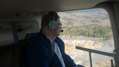 Washington state Governor Jay Inslee looks out of a plane at the area affected by a landslide near State Route 530 in this handout photo provided by the Governor's office taken near Oso, Washington March 23, 2014. Eighteen people remain unaccounted for in a landslide that killed three and injured at least eight more in northwestern Washington state, officials said on Sunday.  REUTERS/Gov Jay Inslee's office/Handout via Reuters  (UNITED STATES - Tags: DISASTER ENVIRONMENT)  ATTENTION EDITORS - THIS IMAGE WAS PROVIDED BY A THIRD PARTY. FOR EDITORIAL USE ONLY. NOT FOR SALE FOR MARKETING OR ADVERTISING CAMPAIGNS. REUTERS IS UNABLE TO INDEPENDENTLY VERIFY THE AUTHENTICITY, CONTENT, LOCATION OR DATE OF THIS IMAGE. THIS PICTURE IS DISTRIBUTED EXACTLY AS RECEIVED BY REUTERS, AS A SERVICE TO CLIENTS