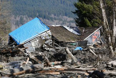 A landslide and structural debris blocks Highway 530 near Oso, Washington March 23, 2014. Eighteen people remain unaccounted for in a landslide that killed three and injured at least eight more in northwestern Washington state, officials said Sunday.  REUTERS/Lindsey Wasson/Pool