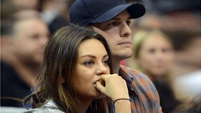 Mila Kunis and fiance Ashton Kutcher watch the game between the Clippers and Pistons at the Staples Center, Saturday, March 22, 2014, in Los Angeles. (Jayne Kamin-Oncea-USA TODAY Sports)