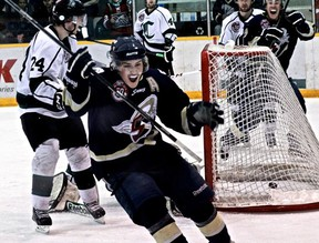 Spruce Grove Saints forward Parker Mackay celebrates his first of two goals on Sunday night. This goal would be the game-winner as the Saints defeated the Sherwood Park Crusaders 5-3 in a do-or-die Game 6 of their AJHL playoff series. Game 7 goes Tuesday in Spruce Grove at 7 p.m. - Kyle Muzyka, Freelance Contributor
